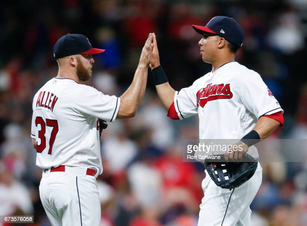 Cody Allen and Michael Brantley of the Cleveland Indians celebrate a 76 victory over the Houston Astros at Progressive Field on April 26 2017 in...