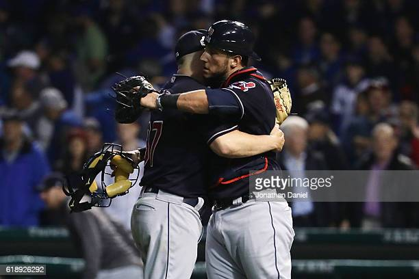 Cody Allen and Roberto Perez of the Cleveland Indians celebrate after beating the Chicago Cubs 10 in Game Three of the 2016 World Series at Wrigley...