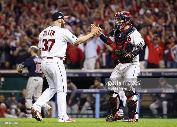 Cody Allen of the Cleveland Indians celebrates with Roberto Perez after defeating the Boston Red Sox 54 in game one of the American League Divison...