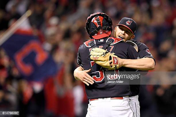 Cody Allen of the Cleveland Indians celebrates with Roberto Perez after defeating the Toronto Blue Jays with a score of 2 to 0 in game one of the...