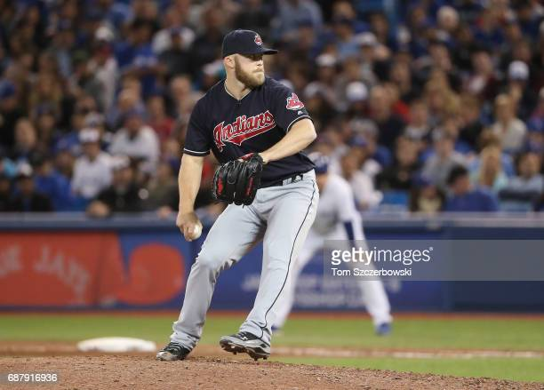 Cody Allen of the Cleveland Indians delivers a pitch in the ninth inning during MLB game action against the Toronto Blue Jays at Rogers Centre on May...