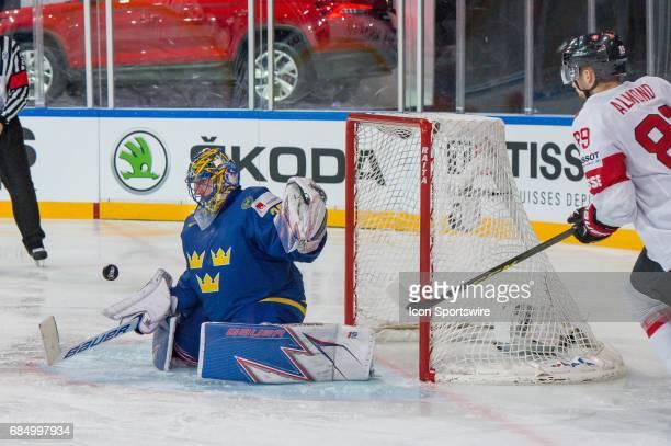 Cody Almond tries to score against Goalie Henrik Lundqvist during the Ice Hockey World Championship Quarterfinal between Switzerland and Sweden at...