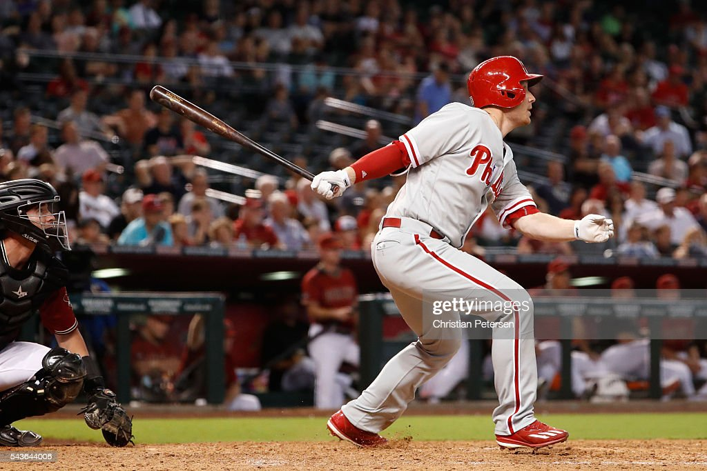 <a gi-track='captionPersonalityLinkClicked' href=/galleries/search?phrase=Cody+Asche&family=editorial&specificpeople=10524550 ng-click='$event.stopPropagation()'>Cody Asche</a> #25 of the Philadelphia Phillies hits a sacrifice fly against the Arizona Diamondbacks during the eighth inning of the MLB game at Chase Field on June 29, 2016 in Phoenix, Arizona.