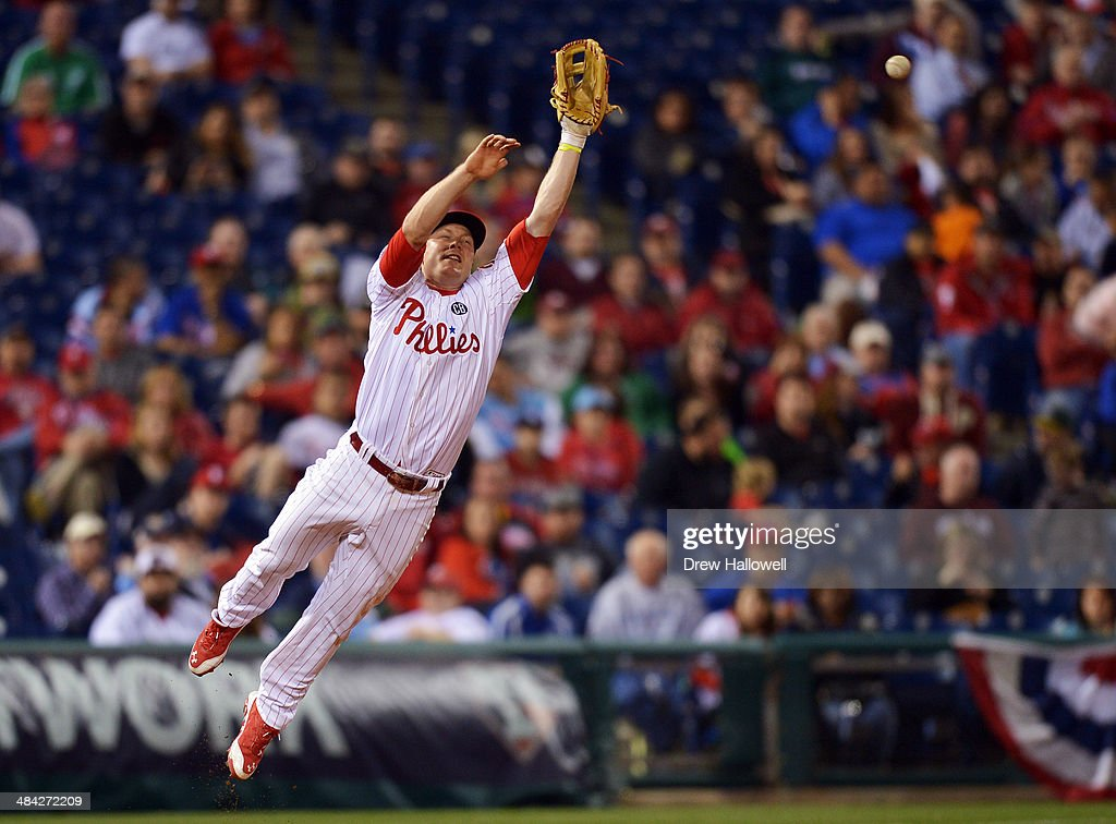 <a gi-track='captionPersonalityLinkClicked' href=/galleries/search?phrase=Cody+Asche&family=editorial&specificpeople=10524550 ng-click='$event.stopPropagation()'>Cody Asche</a> #25 of the Philadelphia Phillies is unable to catch a line drive in the fifth inning at Citizens Bank Park on April 11, 2014 in Philadelphia, Pennsylvania. The Phillies won 6-3.