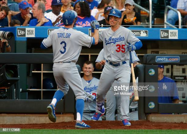 Cody Bellinger and Chris Taylor of the Los Angeles Dodgers in action against the New York Mets at Citi Field on August 5 2017 in the Flushing...