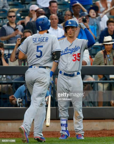 Cody Bellinger and Corey Seager of the Los Angeles Dodgers in action against the New York Mets at Citi Field on August 5 2017 in the Flushing...