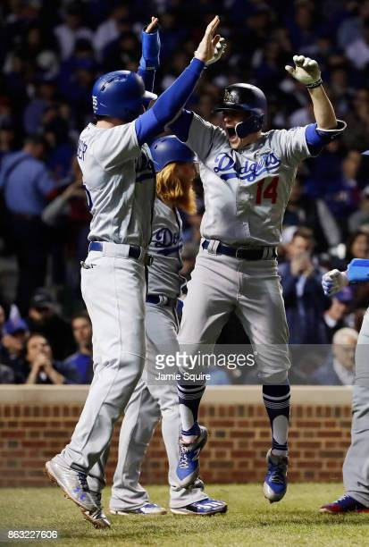 Cody Bellinger and Enrique Hernandez of the Los Angeles Dodgers celebrate after Hernandez hit a grand slam in the third inning against the Chicago...