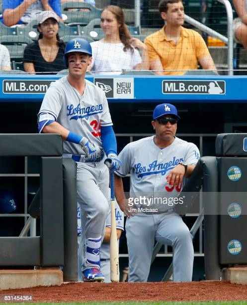 Cody Bellinger and manager Dave Roberts of the Los Angeles Dodgers look on against the New York Mets at Citi Field on August 5 2017 in the Flushing...