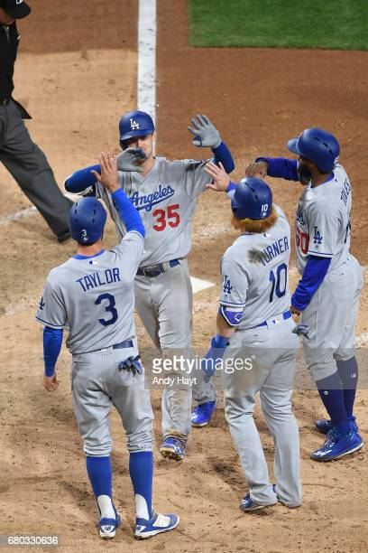Cody Bellinger is congratulated by Chris Taylor Justin Turner and Andrew Toles of the Los Angeles Dodgers after hitting a grand slam during the ninth...