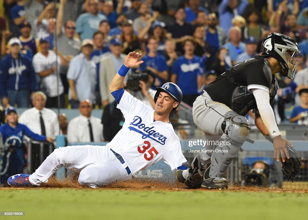 Cody Bellinger #35 of the Los Angeles Dodgers beats the throw to Omar Narvaez #38 of the Chicago White Sox as he scores on a double by Logan Forsythe #11 of the Los Angeles Dodgers in the ninth inning of the game at Dodger Stadium on August 16, 2017 in Los Angeles, California.