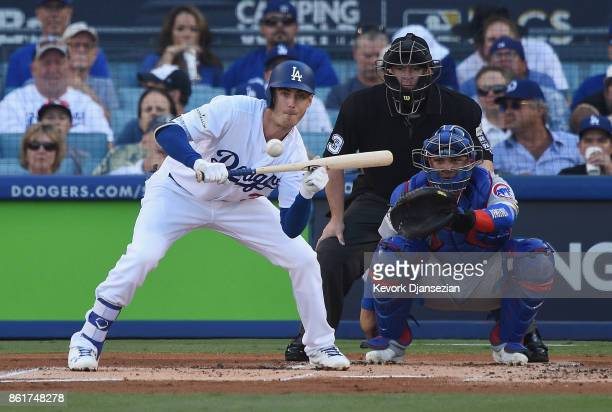 Cody Bellinger of the Los Angeles Dodgers bunts in the first inning against the Chicago Cubs during game two of the National League Championship...