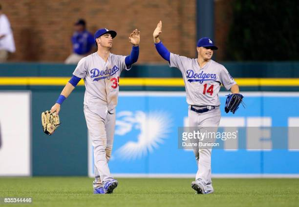 Cody Bellinger of the Los Angeles Dodgers celebrates with Enrique Hernandez of the Los Angeles Dodgers after a 85 win over the Detroit Tigers at...