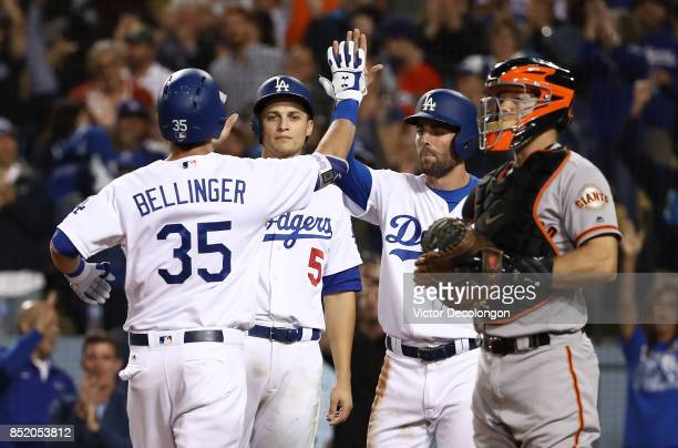 Cody Bellinger of the Los Angeles Dodgers celebrates with teammates Corey Seager and Chris Taylor after hitting a threerun homerun as catcher Nick...