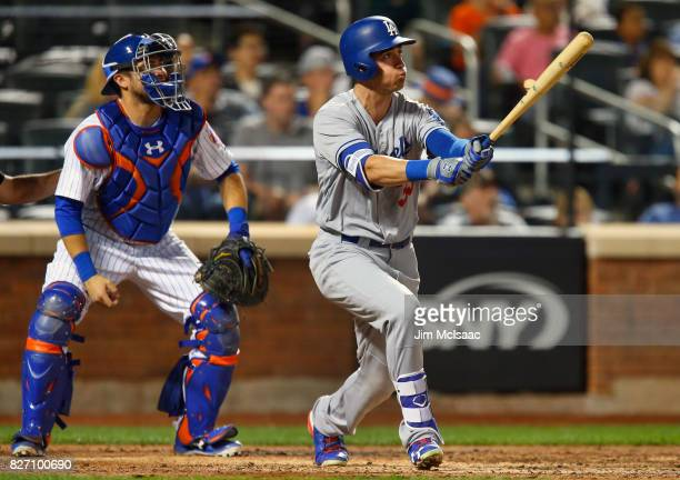 Cody Bellinger of the Los Angeles Dodgers follows through on an eighth inning two run home run against the New York Mets at Citi Field on August 6...