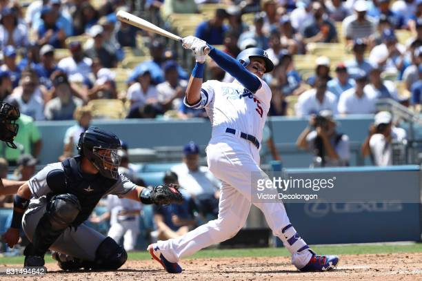 Cody Bellinger of the Los Angeles Dodgers hits a double to right field during the fourth inning of the MLB game against the San Diego Padres at...