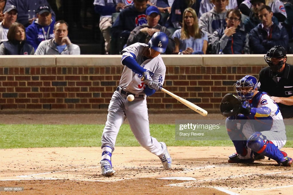 Cody Bellinger #35 of the Los Angeles Dodgers hits a home run in the third inning against the Chicago Cubs during game four of the National League Championship Series at Wrigley Field on October 18, 2017 in Chicago, Illinois.