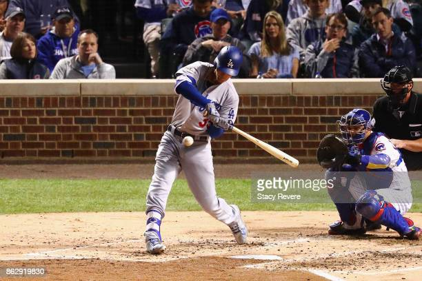 Cody Bellinger of the Los Angeles Dodgers hits a home run in the third inning against the Chicago Cubs during game four of the National League...