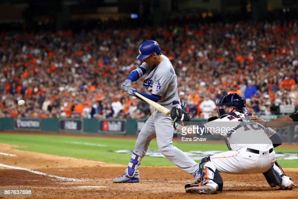 Cody Bellinger of the Los Angeles Dodgers hits a RBI double during the ninth inning against the Houston Astros in game four of the 2017 World Series...
