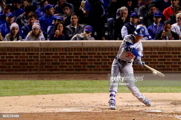Cody Bellinger of the Los Angeles Dodgers hits a single in the third inning against the Chicago Cubs during game five of the National League...