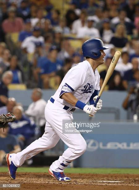Cody Bellinger of the Los Angeles Dodgers hits a single to left field during the fifth inning of the MLB game against the San Diego Padres at Dodger...
