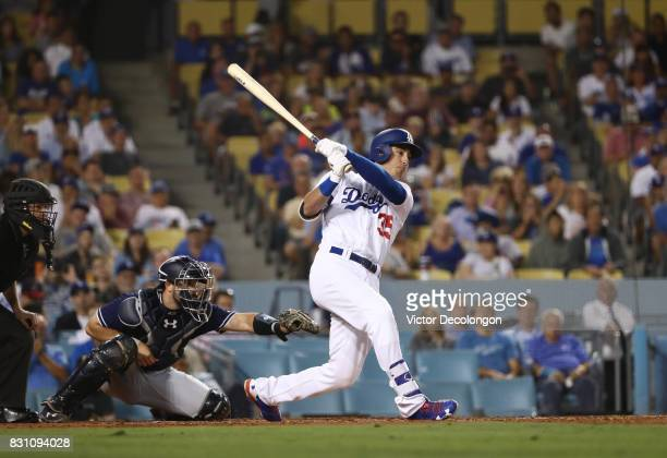 Cody Bellinger of the Los Angeles Dodgers hits an rbi single to right field during the third inning of the MLB game against the San Diego Padres at...