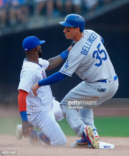 Cody Bellinger of the Los Angeles Dodgers in action against Jose Reyes of the New York Mets at Citi Field on August 5 2017 in the Flushing...