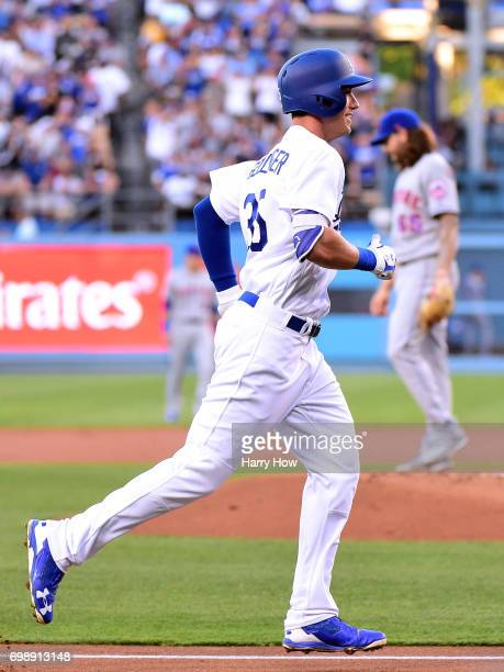 Cody Bellinger of the Los Angeles Dodgers jogs home past Robert Gsellman of the New York Mets after his two run homerun to take a 40 lead during the...