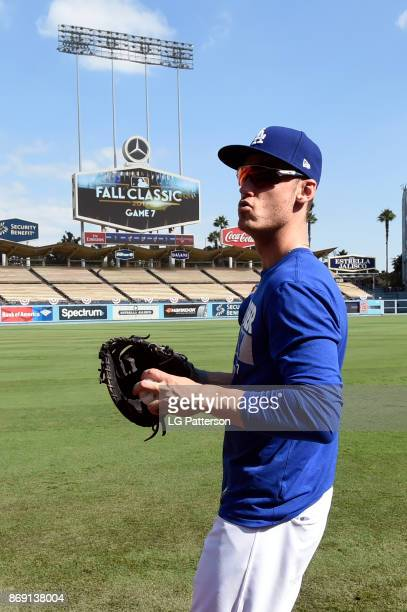Cody Bellinger of the Los Angeles Dodgers looks on during batting practice prior to Game 7 of the 2017 World Series against the Houston Astros at...