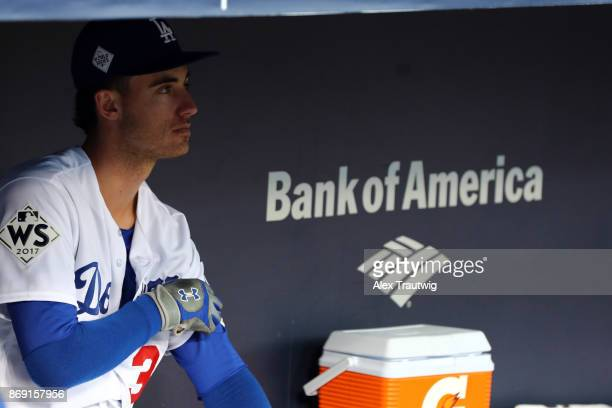 Cody Bellinger of the Los Angeles Dodgers looks on from the dugout prior to during Game 7 of the 2017 World Series against the Houston Astros at...