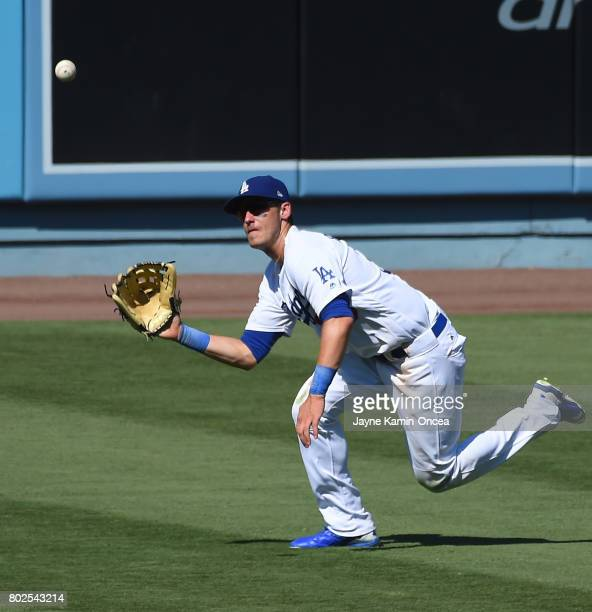 Cody Bellinger of the Los Angeles Dodgers makes a diving catch in the seventh inning of the game against the Colorado Rockies at Dodger Stadium on...