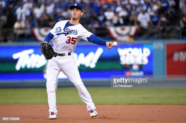 Cody Bellinger of the Los Angeles Dodgers makes an errant throw in the first inning during Game 7 of the 2017 World Series against the Houston Astros...