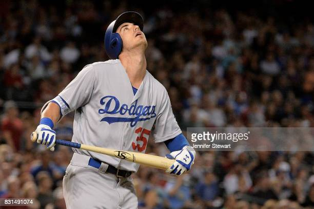 Cody Bellinger of the Los Angeles Dodgers reacts after flying out in the first inning against the Arizona Diamondbacks at Chase Field on August 10...