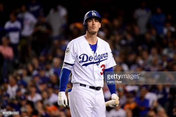 Cody Bellinger of the Los Angeles Dodgers reacts after striking out during the seventh inning against the Houston Astros in game seven of the 2017...