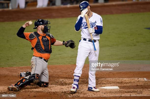Cody Bellinger of the Los Angeles Dodgers reacts as he bats during the third inning against the Houston Astros in game seven of the 2017 World Series...