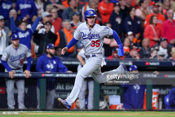 Cody Bellinger of the Los Angeles Dodgers reacts as he scores on a Logan Forsythe single during the seventh inning against the Houston Astros in game...