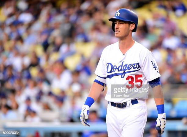 Cody Bellinger of the Los Angeles Dodgers reacts as he strikes out looking during the first inning against the New York Mets at Dodger Stadium on...