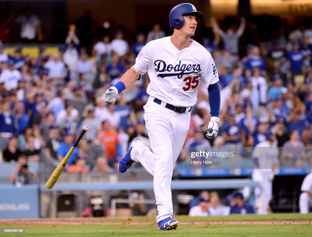 Cody Bellinger #35 of the Los Angeles Dodgers reacts to his solo homerun, his second homerun of the game, to take a 7-0 lead over the New York Mets during the second inning at Dodger Stadium on June 19, 2017 in Los Angeles, California.