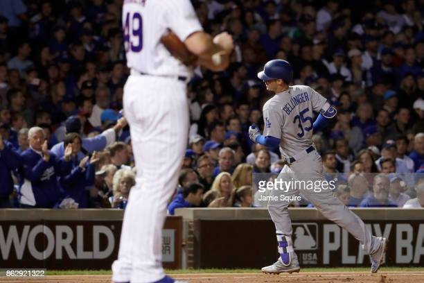 Cody Bellinger of the Los Angeles Dodgers rounds the bases after hitting a home run in the third inning against the Chicago Cubs during game four of...