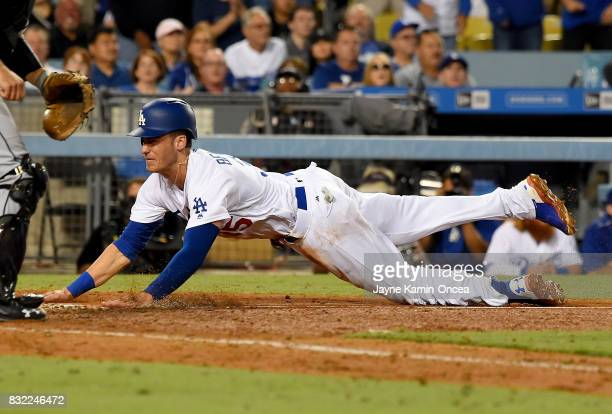 Cody Bellinger of the Los Angeles Dodgers scores from third on a sacrifice fly by Logan Forsythe of the Los Angeles Dodgers in the eighth inning of...