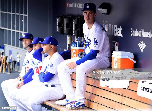 Cody Bellinger of the Los Angeles Dodgers sits in the dugout before game seven of the 2017 World Series against the Houston Astros at Dodger Stadium...