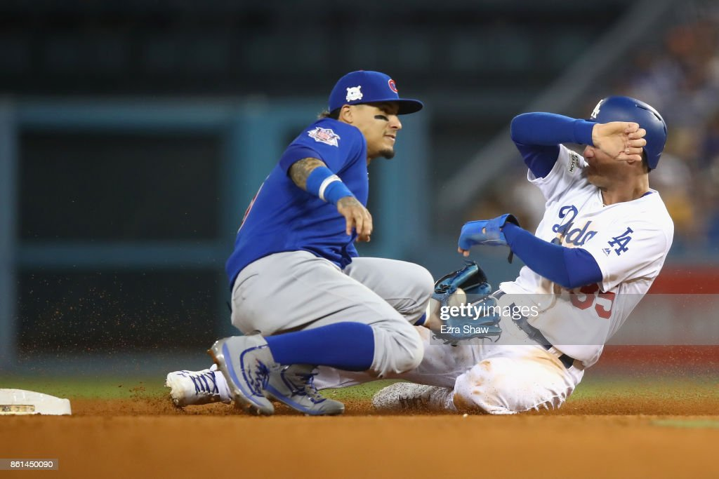 Cody Bellinger #35 of the Los Angeles Dodgers steals second in the sixth inning during Game One of the National League Championship Series at Dodger Stadium on October 14, 2017 in Los Angeles, California.