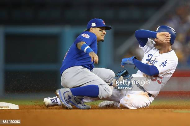 Cody Bellinger of the Los Angeles Dodgers steals second in the sixth inning during Game One of the National League Championship Series at Dodger...