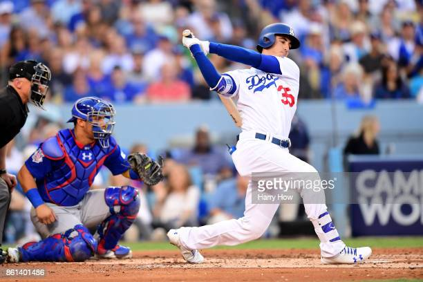 Cody Bellinger of the Los Angeles Dodgers strikes out to end the first inning against Jose Quintana of the Chicago Cubs in Game One of the National...