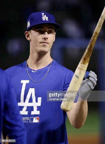 Cody Bellinger of the Los Angeles Dodgers warms up before game four of the National League Championship Series against the Chicago Cubs at Wrigley...