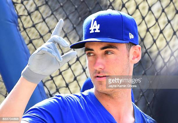 Cody Bellinger of the Los Angeles Dodgers waves to a fan during batting practice before the game against the Chicago White Sox at Dodger Stadium on...