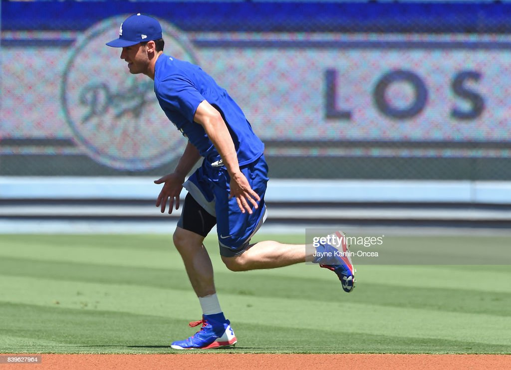 Cody Bellinger #35 of the Los Angeles Dodgers, who has been on the disabled list since August 19, 2017 with a sprained ankle, does sprints in the outfield before the game against the Milwaukee Brewers at Dodger Stadium on August 26, 2017 in Los Angeles, California.