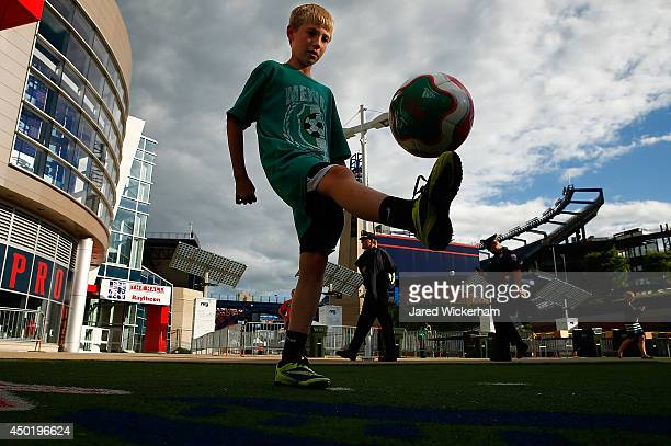 Cody Blackburn juggles a soccer ball outside of Gillette Stadium prior to the international friendly match between Mexico and Portugal on June 6 2014...