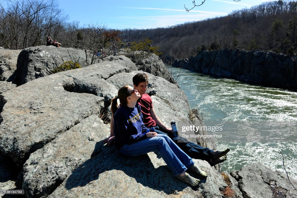 Cody Bouse of Alexandria and Rob Hutchison of Fairfax take in the view of Mather Gorge and the Potomac River as they take a break from hiking the...