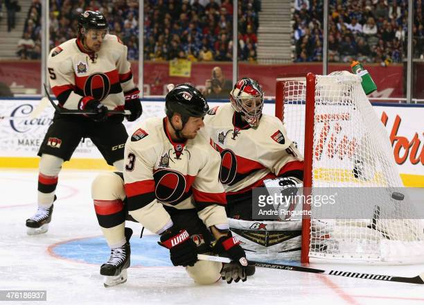 Cody Ceci Marc Methot and goaltender Craig Anderson of the Ottawa Senators defend the net in the second period of the 2014 Tim Hortons NHL Heritage...