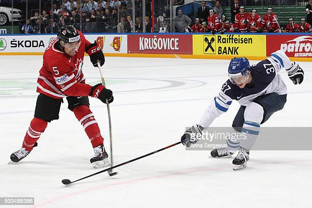 Cody Ceci of Canada plays the puck against Mika Pyorala of Finland during the 2016 IIHF World Championship gold medal game at the Ice Palace on May...